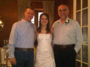 The bride, with her uncle (because I couldn't find her dad) and her grandpa. Ain't she purty?!