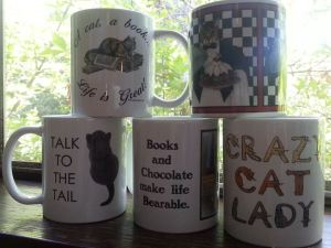 Some of the prizes for the Cat in a Coffee Cup giveaway. Great party on Facebook!